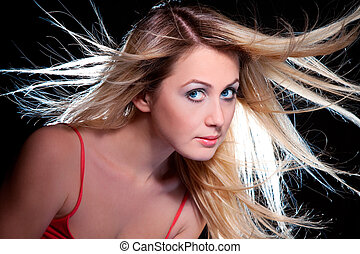 blond girl with flying hair