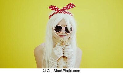 Blond girl with glasses in the image of anime doll