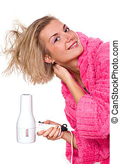 Blond girl with hair dryer