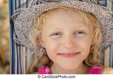 blond girl with hat portrait