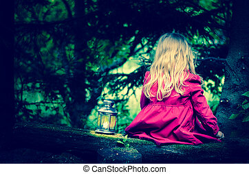 blond girl with lantern