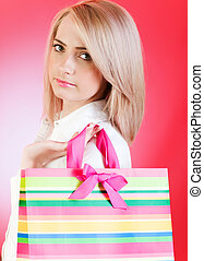 Blond girl with shopping bag