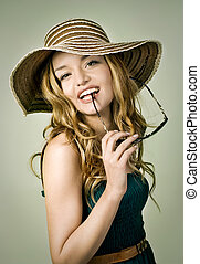 blond girl with summer hat and sunglasses