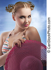 blond girl with summer pink hat