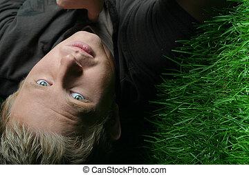 blond guy on grass