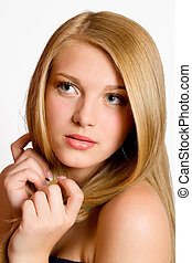 Blond Hair. Close-up portrait of beautiful Woman with Straight Long Hair