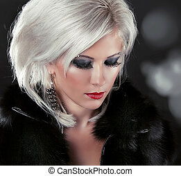 Blond hair styling woman with make up