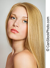 Blond Hair.Close-up portrait of beautiful Woman with Straight Long Hair