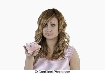 Blond-haired woman sad with her broken piggybank