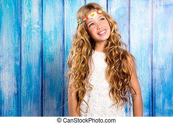 Blond happy hippie children girl smiling on blue wood -...