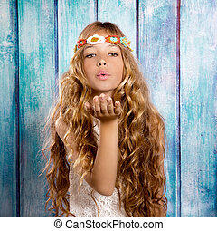 Blond hippie children girl blowing mouth with hand