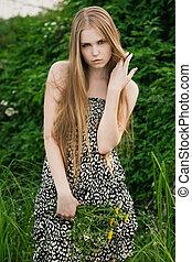 Blond in green grass