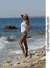 blond in shorts  on shore