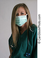 Blond in surgical mask - A blond woman in scrubs and a...