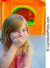 Blond kid girl funny gesture hand in mouth