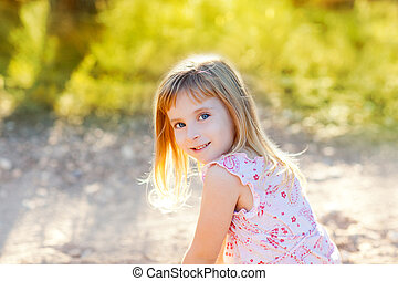 blond kid girl outdoor nature hapy portrait at sunset