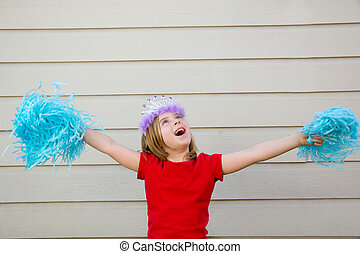 Blond kid girl playing like cheerleading pom poms and crown...