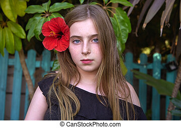 Blond kid girl portrait with red flower