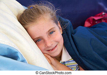 Blond kid girl tired relaxed smiling indented