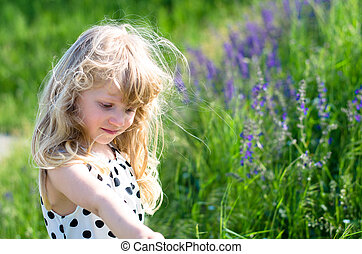 blond kid in meadow