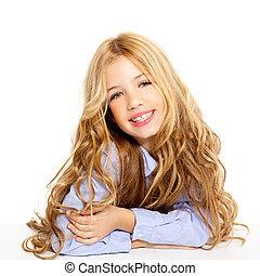 blond kid little girl portrait smiling on a desk in white