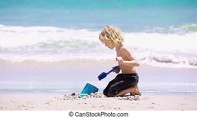 Blond kid playing on the beach - Animation of a blond kid...