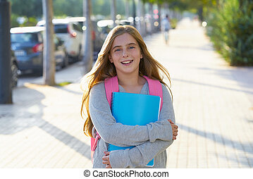 Blond kid student girl in the city