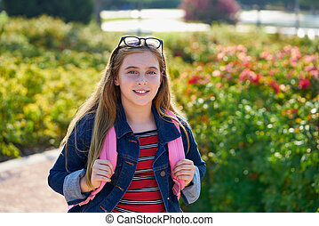 Blond kid student girl in the park