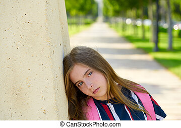 Blond kid student girl sand bored gesture