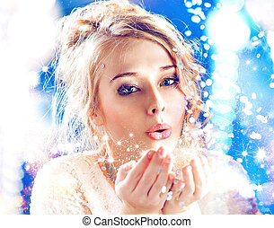Blond lady blowing a magic dust - Blond woman blowing a...