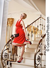 Blond lady standing on a stairs