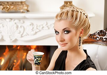Blond lady with a cup portrait