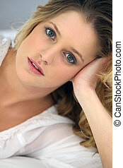 Blond laid down at home