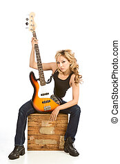 Blond Latina woman guitarist sitting on box