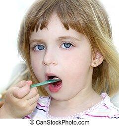 blond little girl eating ice cream portrait