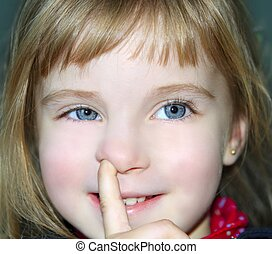 blond little girl portrait finger in nose gesture