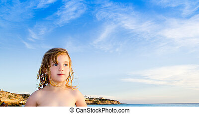 blond little girl portrait in Ibiza beach