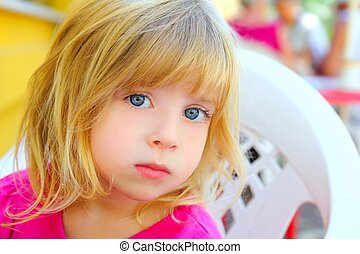 blond little girl portrait looking camera blue eyes