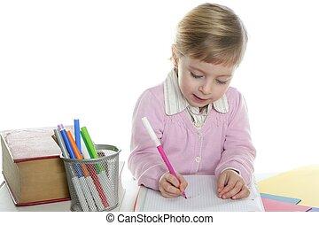 blond little student girl writing desk