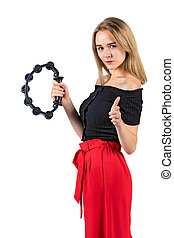 Blond longhaired woman with a tambourine in hands. Isolated on white background.