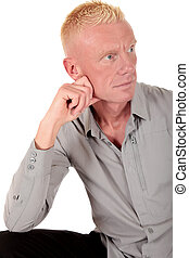 Blond man forties pensive