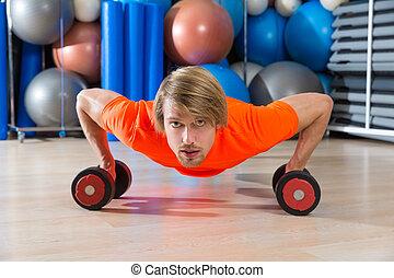 Blond man gym push-up pushup dumbbells