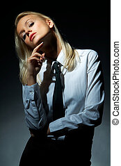 Blond model pose - Blond model, businesswoman pose on black ...