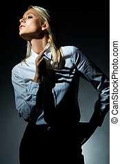 Blond model pose - Blond model, businesswoman pose on black ...