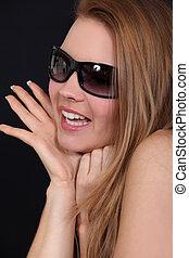 Blond model wearing sunglasses