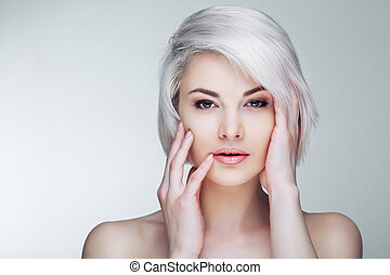 blond model with brown eyes