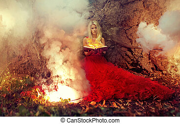 Blond nymph holding firing magic book - Blond woman holding...