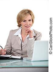 Blond office worker sat at desk