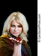 blond older woman holding gems