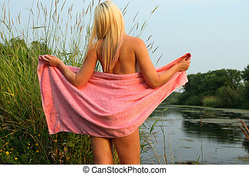 Blond Portrait - Sensual image of a young female partially...